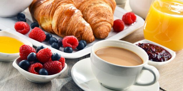 Breakfast served with coffee, orange juice, croissants, cereals and fruits. Balanced