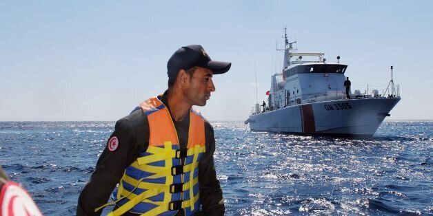 A member of the Tunisian coast guard inspects the maritime borders in the region off Tunisia's northern...