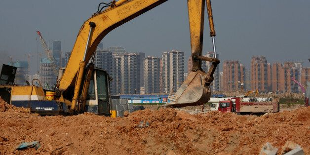 Residential apartments are under construction at Hengqin Island adjacent to Macau, China September 13,...
