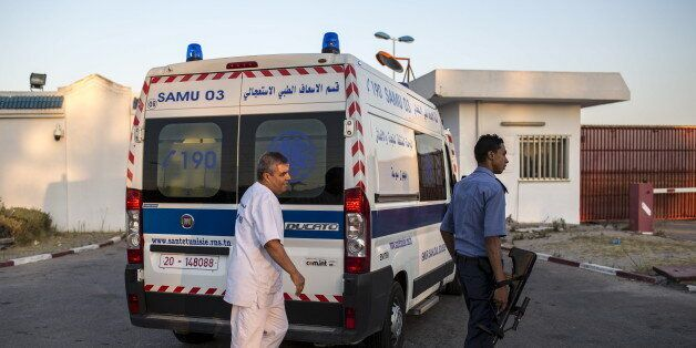 An ambulance carrying British tourists, who were wounded during the Imperial Marhaba hotel attack by...