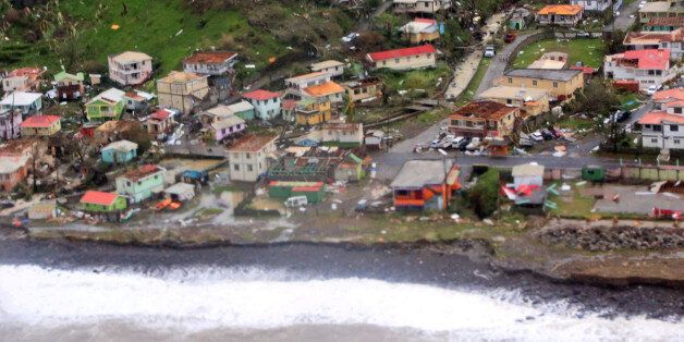 Damaged homes from Hurricane Maria are shown in this aerial photo over the island of Dominica, September...