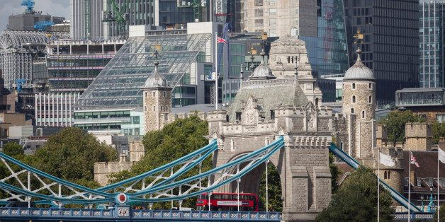 A cityscape of the City of London in the background with the northern abutment tower of Tower Bridge...