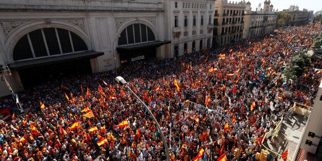 A pro-union demonstration organised by the Catalan Civil Society organisation makes its way through the...