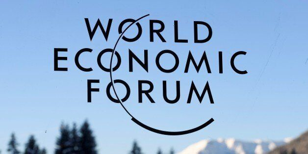 A sign and logo of the World Economic Forum is seen on the third day of the Forum's annual meeting, on...