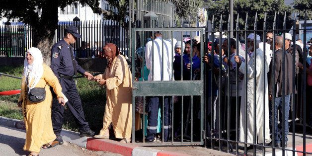 Moroccan police inspect relatives of the leaders of Morocco's Hirak protest movement, as they arrive...