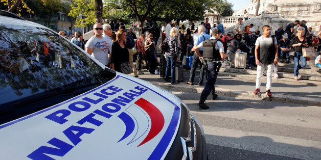 Travellers gather as at police secure the access to the Saint-Charles train station after French soldiers...