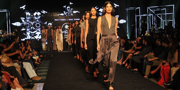 Indian Models Walk the ramp to the display creation of Fashion Designers Rohit Gandhi and Rahul Khanna...