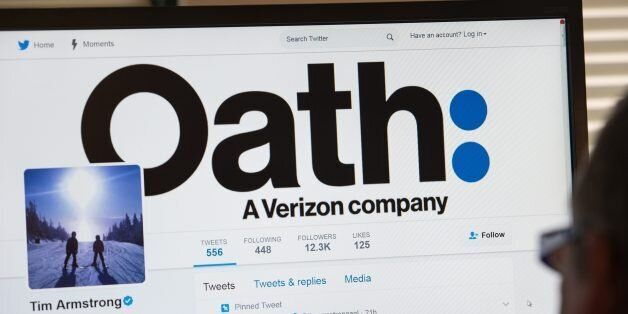 A man looks at the Twitter page of AOL CEO Tim Armstrong announcing Oath on a computer in Washington,...