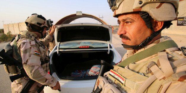 Iraqi army inspect vehicles, Iraq September 8, 2017. Picture taken September 8, 2017. REUTERS/Essam