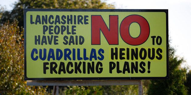 An anti fracking sign stands on the road near the village of Little Plumpton, northern England, October...