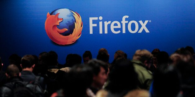 People wait to attend the press conference of Mozilla's Chief Executive Officer (CEO) in Barcelona on...