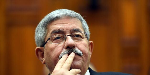 Newly appointed Algerian Prime Minister Ahmed Ouyahia attends a congress session in the capital Algiers...