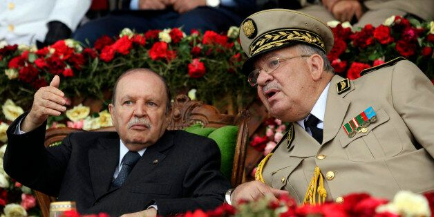 Algeria's President and head of the Armed Forces Abdelaziz Bouteflika (L) gestures while talking with...