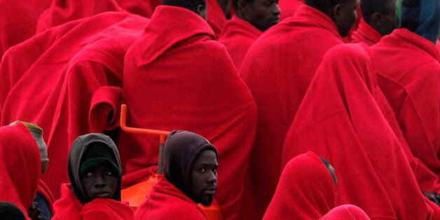 Migrants, who were part of a group intercepted aboard a dinghy off the coast in the Mediterranean sea,...
