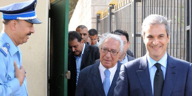 Prince Moulay Hicham (R) cousin of Morocco's King Mohammed VI , is accompanied by his lawyer Abderrahim...