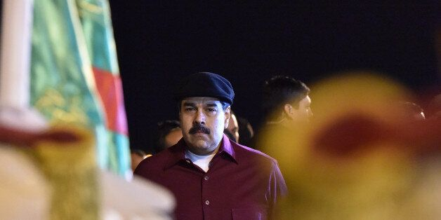 Venezuelan President Nicolas Maduro arrives at the Houari Boumedien Airport in Algiers for a two-day...