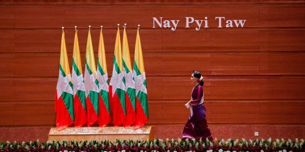 TOPSHOT - Myanmar's State Counsellor Aung San Suu Kyi arrives to deliver a national address in Naypyidaw...