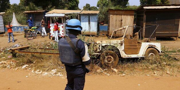 A United Nations peacekeeper stands alongside a road before Pope Francis' visit to the refugee camp of...