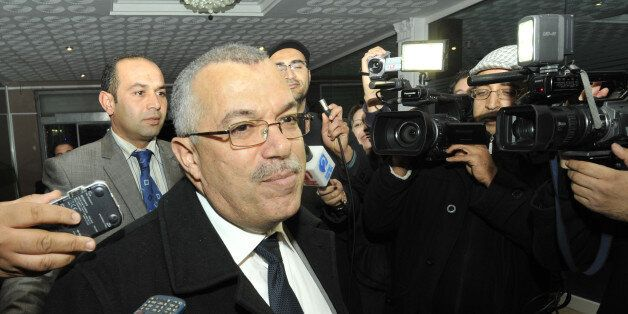 Tunisian justice minister and candidate for the post of prime minister, Noureddine Bhiri speaks to journalists...