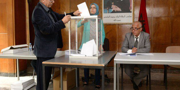 A Moroccan man casts his vote at a polling station in the capital Rabat on October 2, 2015, during an...