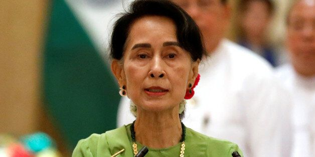 Myanmar State Counselor Aung San Suu Kyi talks during a news conference with India's Prime Minister Narendra...