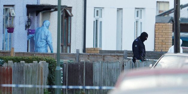 Investigators leave a property being searched after a man was arrested in connection with an explosion...