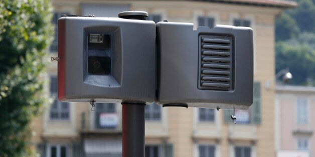 A new automatic traffic light radar is seen defaced on July 13, 2013 in Nice. The automatic radars check...