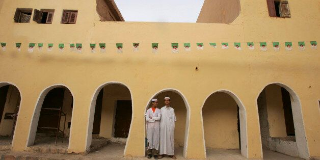 Mzabi men stand under an arcade in Atteuf village in the eastern city of Ghardaia, 600 km (373 miles)...