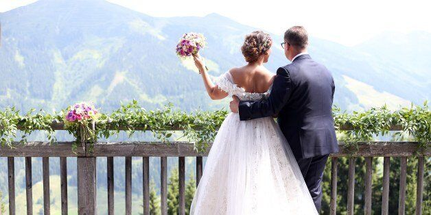 SAALBACH-HINTERGLEMM, AUSTRIA - JULY 22: Bridegroom Torsten Koch and his wife bride Annika Koch during...