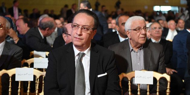 Hafedh Caid Essebsi (C), leader of Nidaa Tounes party, looks on as he attends an official speech delivered...