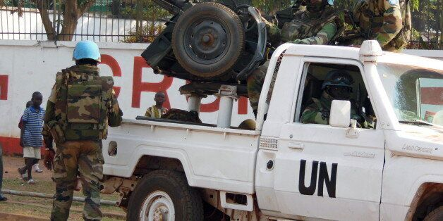U.N. peacekeepers take a break as they patrol along a street during the presidential election in Bangui,...