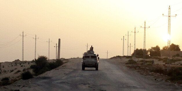 FILE PHOTO: An Egyptian military vehicle is seen on the highway in northern Sinai, Egypt, May 25, 2015....