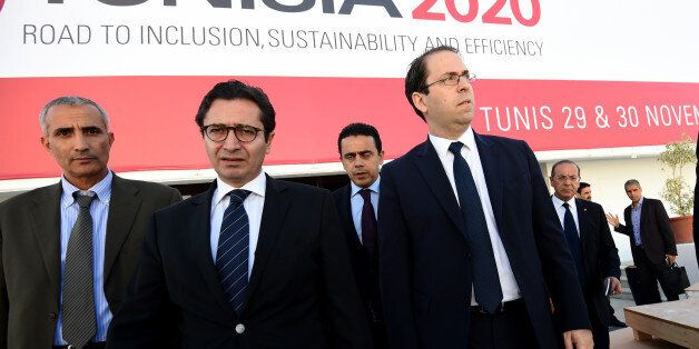 Tunisian Prime Minister Youssef Chahed (R) and Tunisia's Investment and International Cooperation Minister...