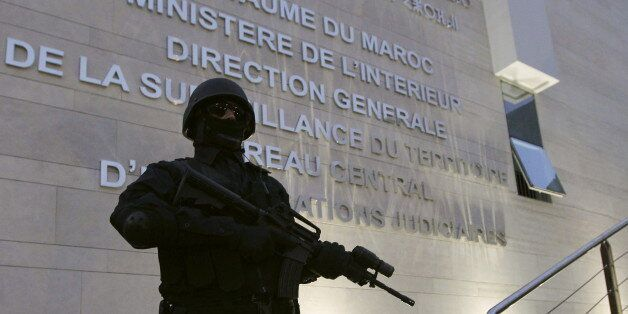 A Moroccan policeman stands guard at the Central Bureau of Judicial Investigation office in Sale, March...