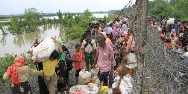 Ethnic minority group Rohingya refugees of Myanmar gather Bangladesh-Myanmar border fence at Maungdaw...