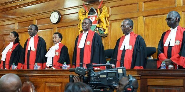 Judges stand to deliver their verdict at the Supreme Court in Nairobi on September 1, 2017, ordering...