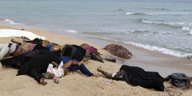EDITORS NOTE: Graphic content / The bodies of illegal migrants are seen lying on the beach in Garabulli,...