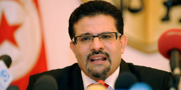 Tunisian Foreign Minister Rafik Abdessalem speaks with journalists during a press conference on August...