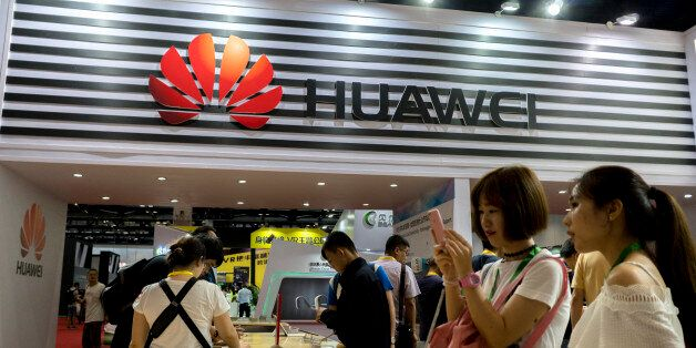 BEIJING, CHINA - 2017/07/08: Customers are trying the new Huawei smart phones. Huaweis shipment for Q2...