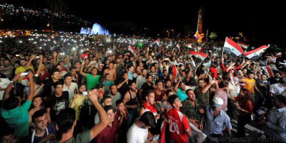Les Syriens envahissent les rues pour fêter leur accès aux barrages pour le Mondial