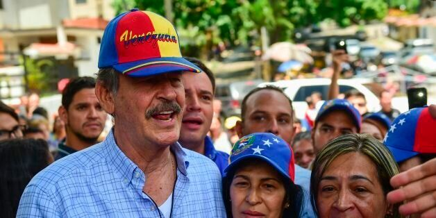 Former Mexican president Vicente Fox (L), named by the Venezuelan opposition as an observer to the opposition-organized...