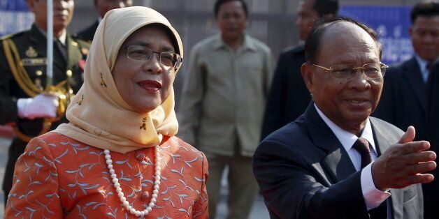 Halimah Yacob (L), Speaker of the Parliament of Singapore inspects the honour guard, accompanied by Cambodia's...