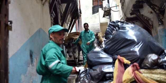 Garbage collectors lead donkeys in the old part of Algiers, known as the 'Kasbah', on May 22, 2017 as...