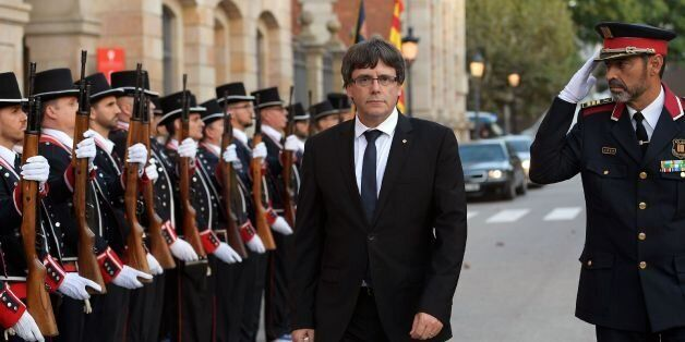 President of the Catalan regional government Carles Puigdemont (2R) and Josep Lluis Trapero (R), chief...