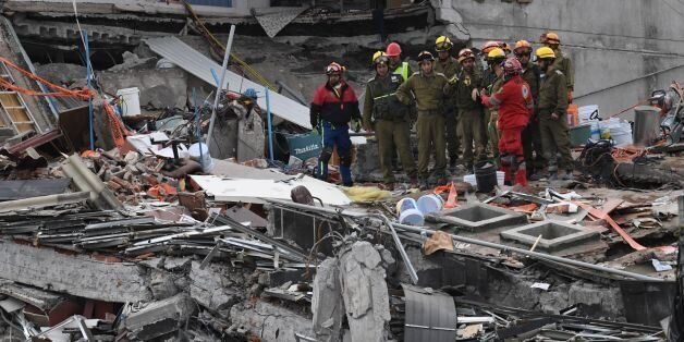Rescue workers continue to search for survivors in Mexico City on September 23, 2017, four days after...