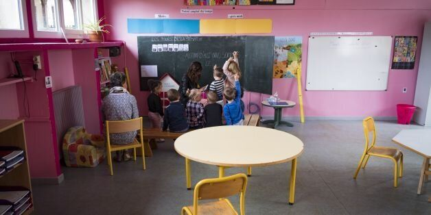 Children attend a lesson with their teacher in the preschool in Molieres, southwest France, on September...
