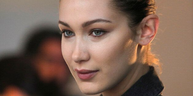 Model Bella Hadid waits backstage before the Michael Kors Autumn/Winter 2017 collection presentation...