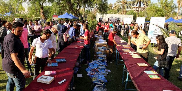 Iraqis attend the 'I'm Iraqi, I Read' cultural festival at Abu Nawas street, along the Tigris river in...