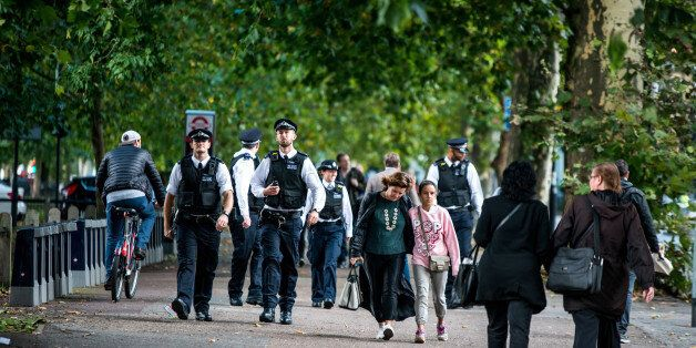 PARSONS GREEN, LONDON, UNITED KINGDOM - 2017/09/15: Police officers near to Parsons Green. Several people...