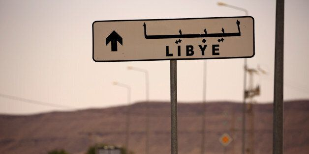 A road sign shows the direction of Libya near the border crossing at Dhiba, Tunisia April 11, 2016. Tunisia's...